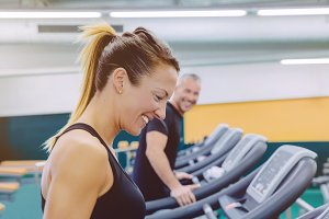 Fitness woman laughing in treadmill