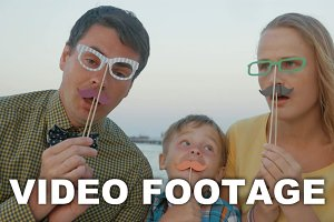 Family of three with hipster glasses