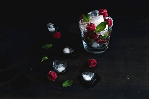 Ice cubes with frozen raspberry