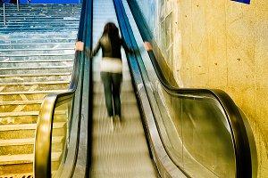 Woman using Escalator