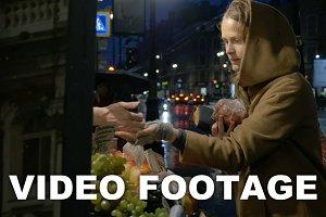 Woman buying fruit in outdoor market