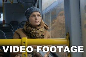 Woman passenger looking bus window