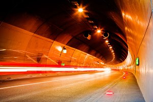 Cars moving fast in a tunnel