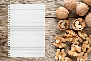 Walnuts and paper for recipe