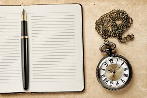 Diary with fountain pen and watch