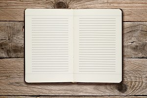 Open diary on wooden background
