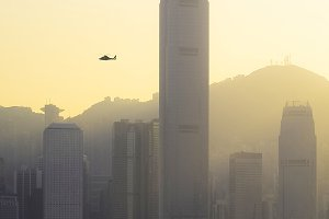Helicopter flying in Hong Kong sky