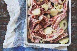 Raw lamb chops marinated
