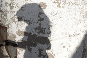 Shadow of woman projected on wall