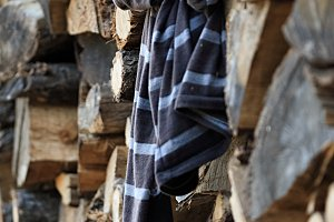 Clothes on pile of wooden logs