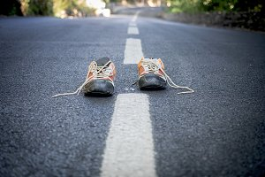 Pair of sneakers on the road