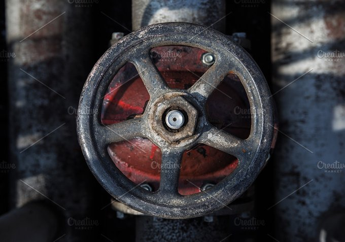 old handwheel of valve. top view - Industrial