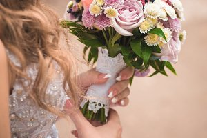 Beautiful wedding bouquet in hands o