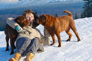 Woman hugging her dogs