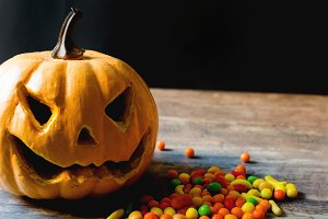 Halloween pumpkin and candies