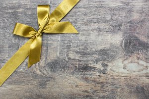 Christmas ribbon on wood background
