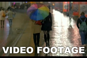 City walk under colorful umbrella