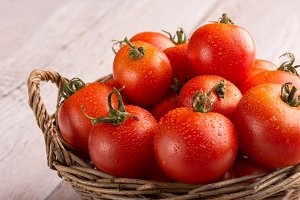 fresh tomatos in a basket