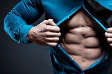 Young man displaying his abdominal