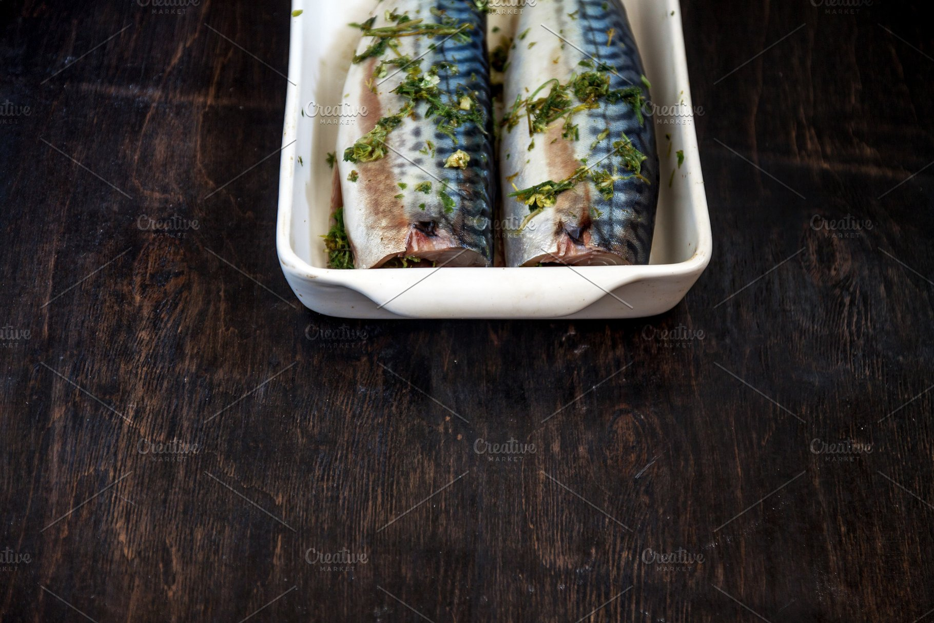 0123908d33f6 two raw fish mackerel in greens and