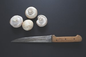 Old kitchen knife and mushrooms
