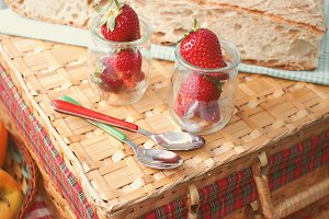 Strawberries on picnic suitcase