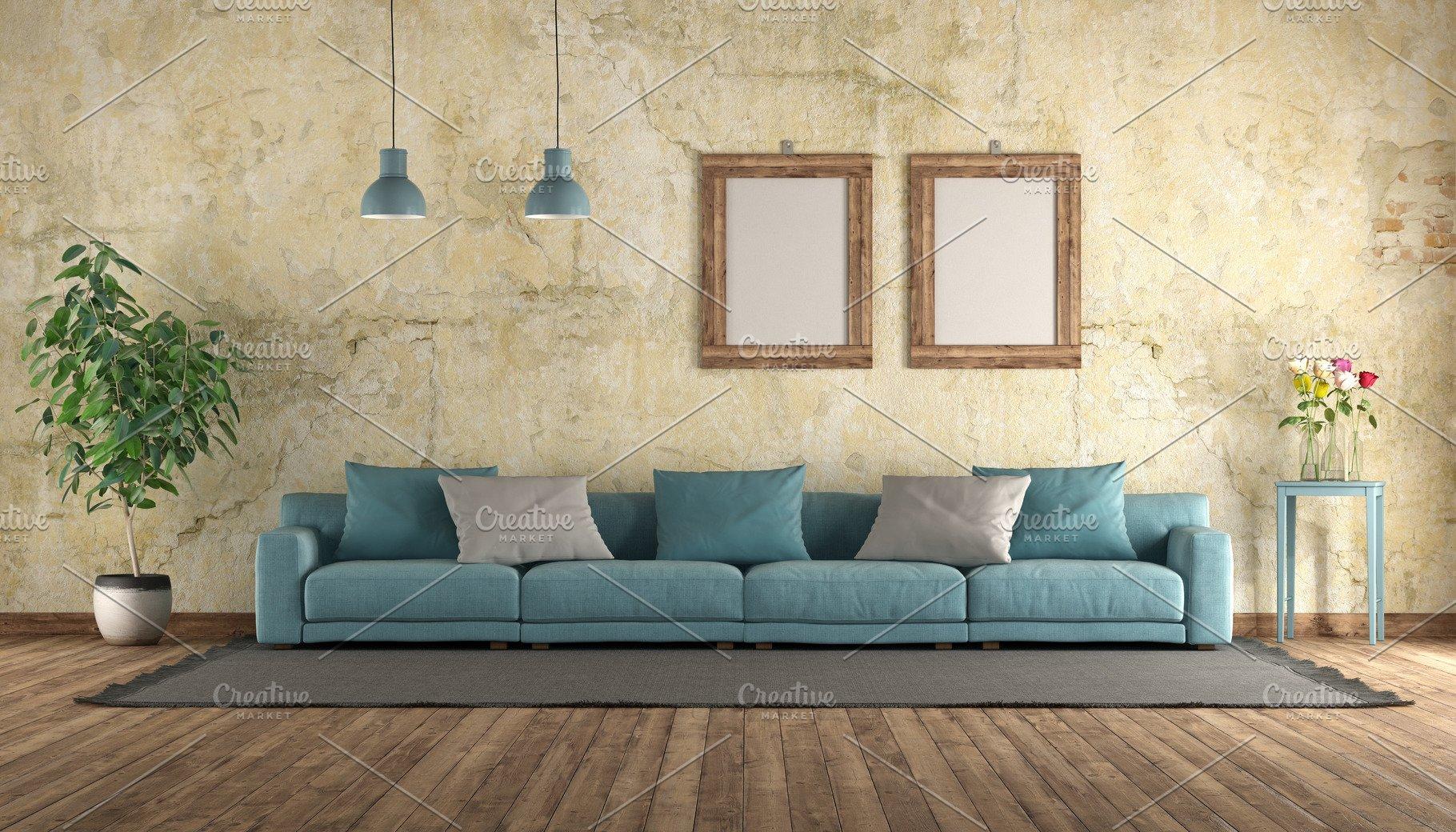 Modern blue sofa in a grunge room