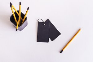 Mockup. Black business tag, pencil.
