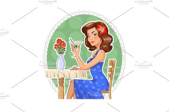 Beautiful girl with glass of martini