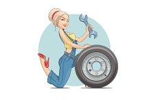 Beautiful girl mechanic with wheel