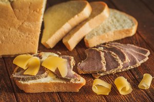Bread with butter and slices of veal