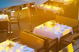 Luxury beach restaurant in sunlight