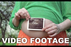 Pregnant Woman Holding a Sonogram