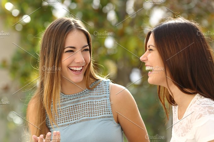 Happy women talking and laughing.jpg - People