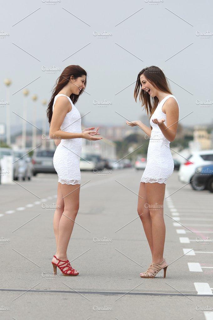 Happy women wearing the same dress.jpg - Beauty & Fashion