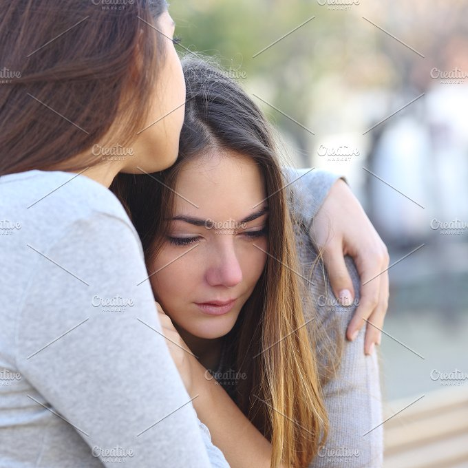 Sad girl crying and a friend comforting her.jpg - People
