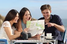 Group of young tourist friends consulting a paper map.jpg