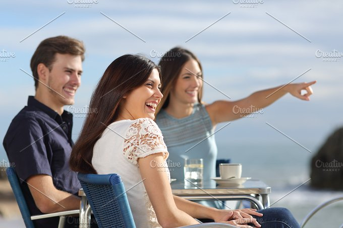 Group of friends looking at horizon in a restaurant.jpg - People