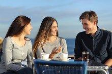 Friends talking in a restaurant on the beach.jpg