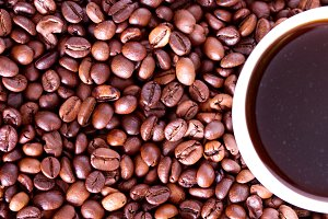 Cup of coffee on a background coffee