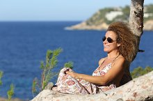 Tourist woman relaxing on the beach in vacations.jpg