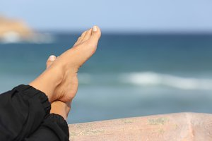Woman feet relaxing on an hotel beach terrace.jpg