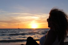 Woman silhouette watching a sunset in Ibiza.jpg