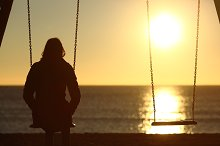 Lonely woman watching sunset alone in winter.jpg