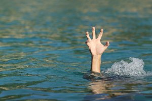 Hand of a man drowning in the sea.jpg
