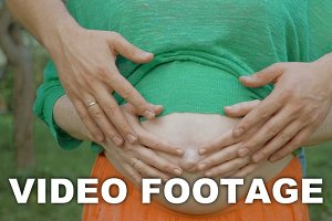 Parent's Hands on Belly with Unborn