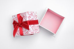 Open white gift box hearts top