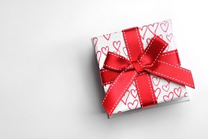 White gift box hearts isolated top