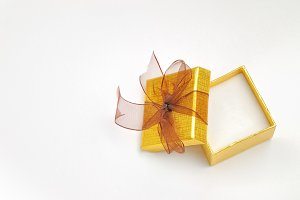 Open golden gift with brown tie top