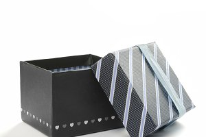 Open black gift box and ribbon front